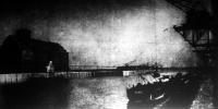 A csepeli kikötő kereskedelmi medencéje a tizenkétemeletes gabonatárházzal