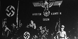A magyarországi német munkásság ünnepén dr. Edmund Veesenmayer beszél a nemzeti munka jelentőségéről az egyik fegyverkezési üzem munkatermében (május).