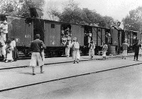 Román aratómunkások vonatra szállása. (Nagyvárad)