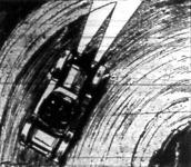 Kocsi a fordulóban fix lámpákkal